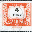 Stock Photo: HUNGARY - CIRC1958: stamp printed in Hungary, is depicted porto-mark, shield, face value 4 filler, circ1958