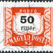 Stock Photo: HUNGARY - CIRC1958: stamp printed in Hungary, is depicted porto-mark, shield, face value 50 filler, circ1958