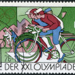 Royalty-Free Stock Photo: DDR - CIRCA 1976: A stamp printed in DDR, devoted to the Summer Olympics in Montreal, depicts Peace Bicycle Race and Olympic Rings, circa 1976