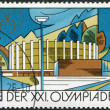 Royalty-Free Stock Photo: DDR - CIRCA 1976: A stamp printed in DDR, devoted to the Summer Olympics in Montreal, is depicted Town and sport halls, Suhl, circa 1976