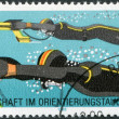 DDR - CIRCA 1985: A stamp printed in DDR, is dedicated to 2nd World Orienteering and Deep-sea Diving Championship, shows a long-distance divers, circa 1985 — Stock Photo