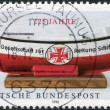 Stock Photo: GERMANY - CIRC1990: stamp printed in Germany, dedicated to 125 anniversary of GermLife Boat Institution, circ1990