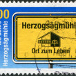 Foto de Stock  : GERMANY - CIRC1994: stamp printed in Germany, dedicated to anniversary of Social Welfare Organization, shows Herzogsagmuhle, circ1994