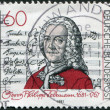 "GERMANY - CIRCA 1981: A stamp printed in the Germany, shows Georg Philipp Telemann, Title Page of ""Singet dem Herrn"" Cantata, circa 1981 - Stock Photo"