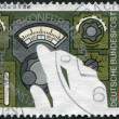 Stock Photo: GERMANY - CIRC1979: stamp printed in Germany, dedicated to World Administrative Radio Conference in Geneva, is depicted Hand Setting Radio Dial, circ1979