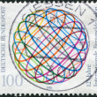 Stock Photo: GERMANY - CIRC1990: stamp printed in Germany, dedicated to 125th anniversary of International Telecommunication Union, shows stylized globe, circa