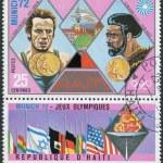 Постер, плакат: HAITI CIRCA 1973: A stamp printed in Haiti shows Olympic Gold Medallist in Munich in 1972 Lasse Viren and Rod Milburn circa 1973