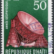 HAITI - CIRCA 1958: A stamp printed in Haiti, is devoted to International Geophysical Year (IGY), shows a radiotelescope at Jodrell Bank, circa 1958 — Stock Photo
