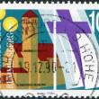 Stock Photo: GERMANY - CIRC1990: stamp printed in Germany, dedicated to 100th anniversary of Rummelsberg Diaconal Institution, circ1990