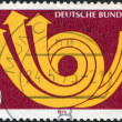 GERMANY - CIRCA 1973: A stamp printed in the Germany, shows a stylized postal horn, circa 1973 — Stock Photo
