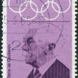 A stamp printed in the Germany, dedicated to the 19th Olympic Games, Mexico City, shows the Pierre de Coubertin — Φωτογραφία Αρχείου #12757258