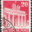 A stamp printed in Germany (West Berlin, American and British occupation zone) shows the Brandenburg Gate - Stock Photo