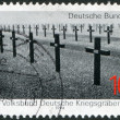 Stamp printed in Germany, is dedicated to 75th anniversary of National Association for Preservation of GermGraves Abroad, shows soldier's graveyard — Stock Photo #12757384