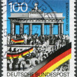 A stamp printed in Germany, is dedicated to the first anniversary of the fall of the Berlin Wall shows around the Brandenburg Gate — Stock Photo