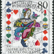 Royalty-Free Stock Photo: A stamp printed in Germany, is dedicated to the 100th anniversary of the German Skat Congress, shows the Tournament card