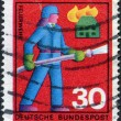Stock Photo: Stamp printed in Germany, shows firemto extinguish fire