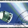 "A stamp printed in Germany, shows a European robotic spacecraft ""Giotto"" and Halley's Comet - Stock Photo"