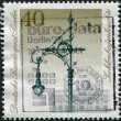 A stamp printed in Germany, shows a Historic Street Lanterns: Carbon arc lamp — Stock Photo