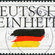 A stamp printed in Germany, is devoted to German Reunification - Stock Photo