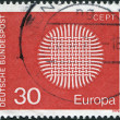 A stamp printed in Germany, shows weaving as a symbol of the sun — Stock Photo