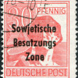 A stamp printed in Germany, is shown worker with a hammer (overprint, the Soviet occupation zone) — Stock Photo