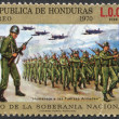 A stamp printed in the Honduras, shows a military parade on national sovereignty — Stock Photo