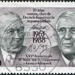 Постер, плакат: A stamp printed in Germany dedicated to 25th anniversary of the Franco German Cooperation Treaty shows the Konrad Adenauer and Charles de Gaulle
