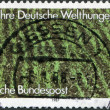 A stamp printed in Germany, is dedicated to the 25th anniversary of German Agro Action Organization, shows a rice field - Stock Photo