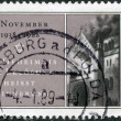 "A stamp printed in Germany, is dedicated to 1st Nazi Pogrom, shows a Star, ""Remembering is the secret of redemption,"" and burning synagogue in Baden-Baden - Stock Photo"