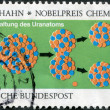 A stamp printed in Germany, is devoted to German Nobel Prize winner, Otto Hahn, chemistry, shows a diagram of the splitting of the uranium nucleus - 