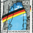 A stamp printed in Germany, is dedicated to the first anniversary of the fall of the Berlin Wall — Stock Photo