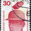 Stock Photo: Stamp printed in Germany, is dedicated to Accident prevention displayed Safety helmets prevent injury
