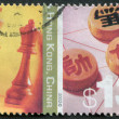 A stamp printed in the Hong Kong, shows Chess and Xiangqi — Stock Photo