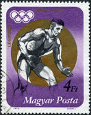 HUNGARY - CIRCA 1973: A stamp printed in Hungary, is devoted to the Summer Olympics in Munich, the Olympic champion shows Csaba Hegedus, circa 1973 — Stock fotografie