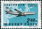 HUNGARY - CIRCA 1977: A stamp printed in Hungary, is devoted to airmail, shows Airbus A300B over the map of Europe, circa 1977 — Stock Photo