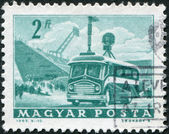 HUNGARY - CIRCA 1963: A stamp printed in Hungary, is depicted Mobile radio transmitter and stadium, circa 1963 — Stock Photo