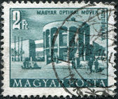 HUNGARY - CIRCA 1953: A stamp printed in Hungary, is depicted Optical works house of culture, circa 1953 — Stock Photo