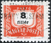 HUNGARY - CIRCA 1958: A stamp printed in Hungary, is depicted porto-mark, a shield, face value 8 filler, circa 1958 — ストック写真