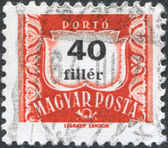 HUNGARY - CIRCA 1958: A stamp printed in Hungary, is depicted porto-mark, a shield, face value 40 filler, circa 1958 — Stock Photo