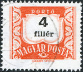 HUNGARY - CIRCA 1958: A stamp printed in Hungary, is depicted porto-mark, a shield, face value 4 filler, circa 1958 — Stock Photo