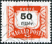 HUNGARY - CIRCA 1958: A stamp printed in Hungary, is depicted porto-mark, a shield, face value 50 filler, circa 1958 — Stock Photo