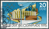 DDR - CIRCA 1976: A stamp printed in DDR, devoted to the Summer Olympics in Montreal, is depicted Town and sport halls, Suhl, circa 1976 — Stock Photo