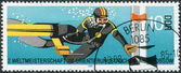 DDR - CIRCA 1985: A stamp printed in DDR, is dedicated to 2nd World Orienteering and Deep-sea Diving Championship, shows diver at turning buoy, circa 1985 — Stock Photo