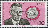 DDR - CIRCA 1980: A stamp printed in DDR, shows Frederic Joliot-Curie and atomic model, circa 1980 — Stock Photo