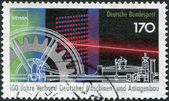 A stamp printed in the Germany, dedicated to the 100th anniversary of the Association of German Plant and Machine Builders, shows a Petrol engine, Gear, and Computer — Stock Photo