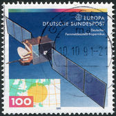A stamp printed in Germany, shows a geostationary satellite DFS Kopernikus — Stock Photo