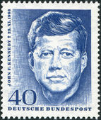A stamp printed in Germany, shows the U.S. president, John F. Kennedy — Stock Photo
