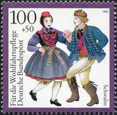 A stamp printed in Germany, is dedicated to Traditional Costumes, shows Schwalm, Hesse — Foto de Stock
