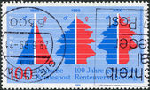 A stamp printed in Germany, is dedicated to the 100th anniversary of Social Security Pension Insurance, a graph of age — Stock Photo