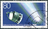 "A stamp printed in Germany, shows a European robotic spacecraft ""Giotto"" and Halley's Comet — Stock Photo"